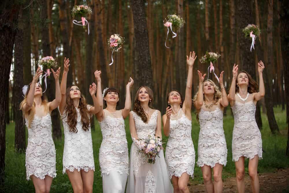 Bride and bridesmaids throwing wedding bouquets