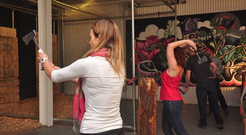 girls throwing axes