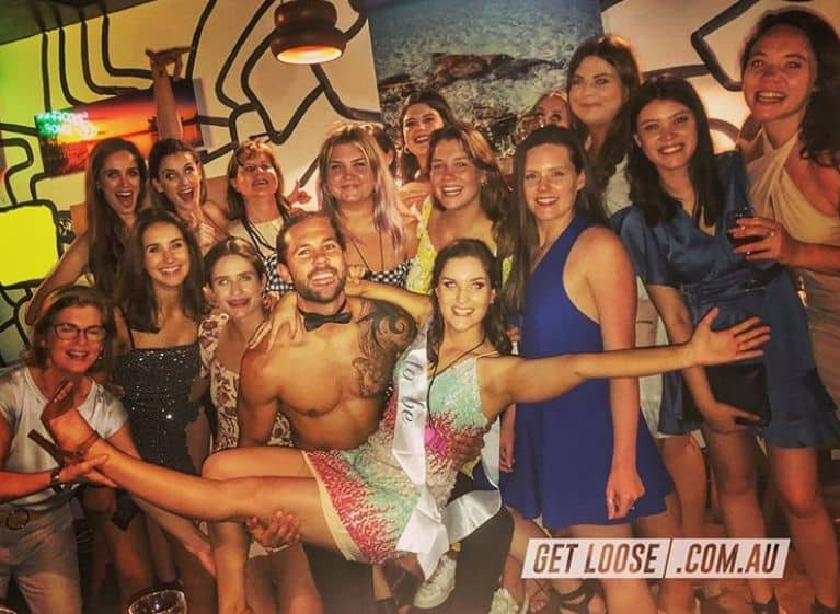 girls and topless waiter