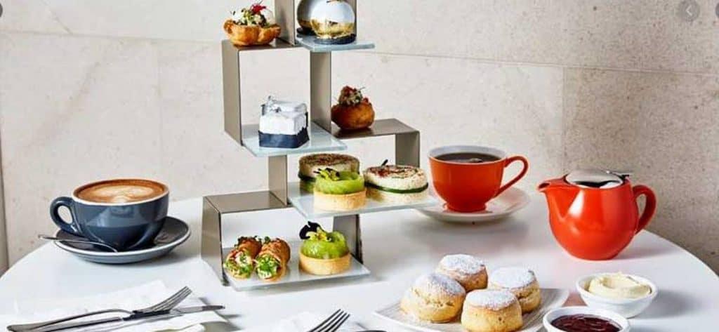 fancy hilton high tea with cakes