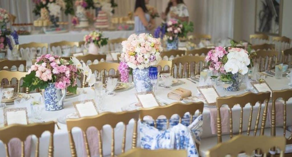 golden chairs and flowers high tea set up