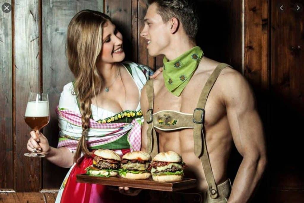 topless german waiter with burgers and girl with beer