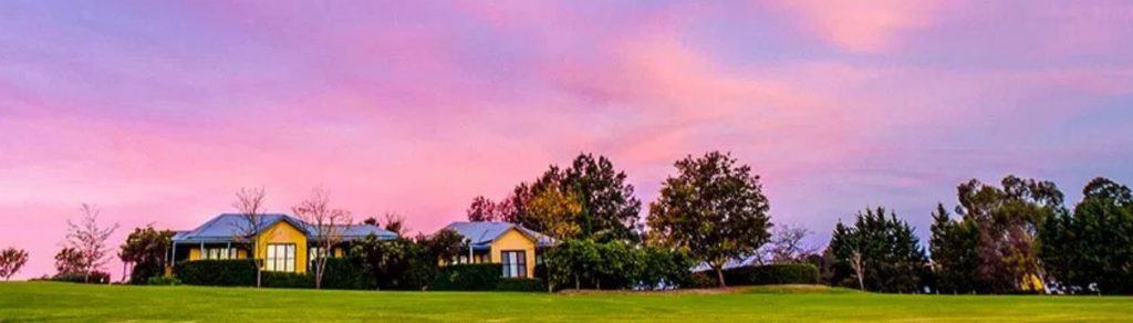 house on prarie with purple sunset