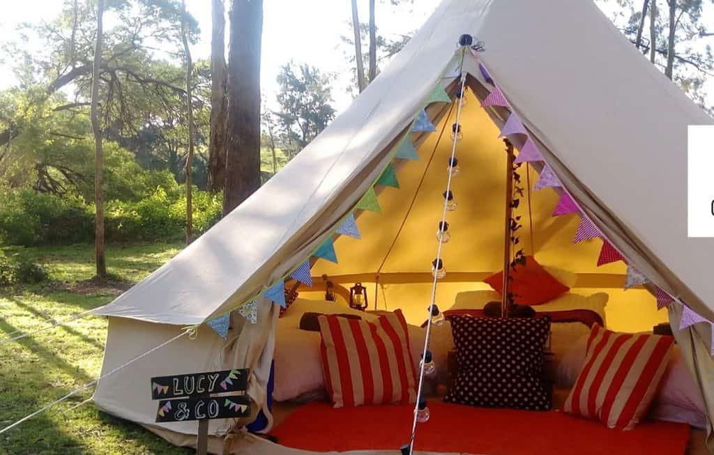pitched tent with pillows