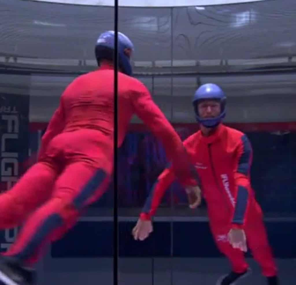 indoor skydiver in red suit