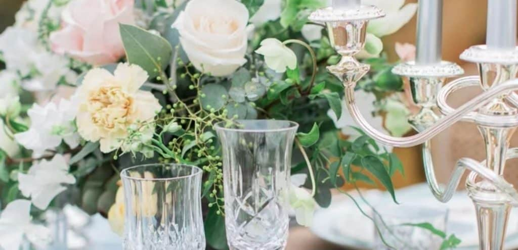 vintage champagne glasses and green and white bouquet
